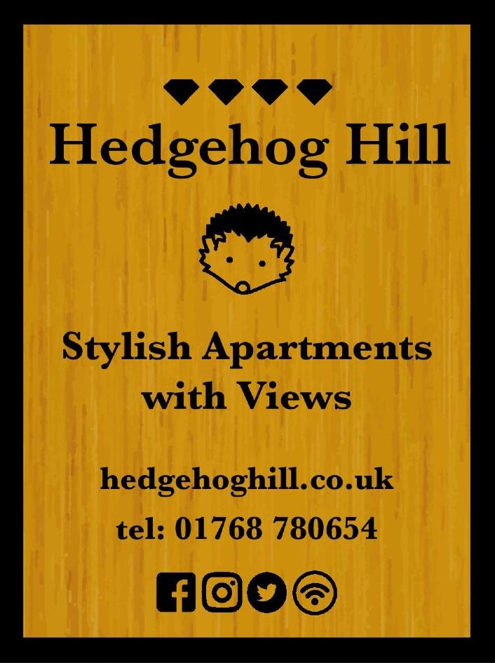 Hedgehog hill apartments sign